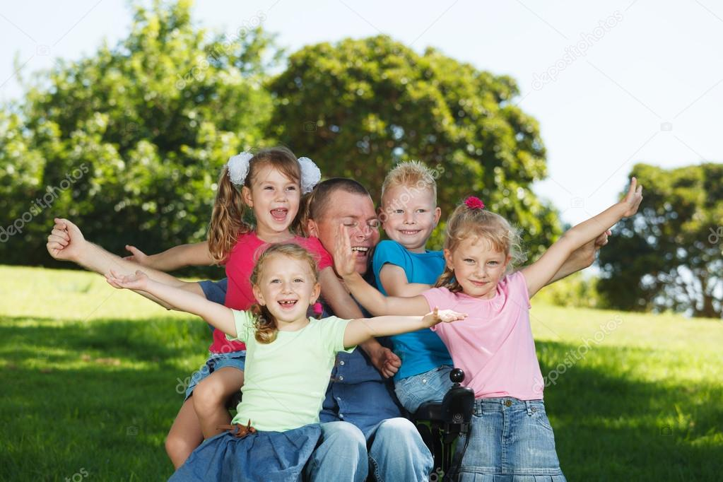 Disabled dad play with children