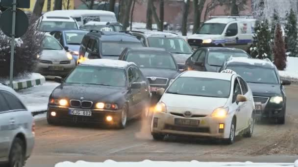 Slow cars traffic at Chisinau streets during snowy winnter