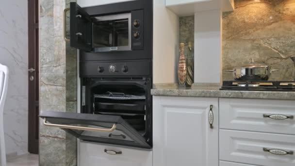 Closeup panning of modern classic white kitchen interior