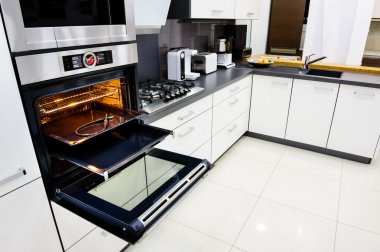 Modern hi-tek kitchen, oven with open door