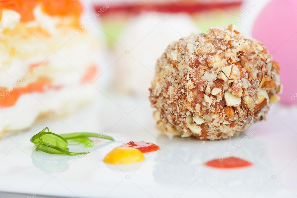 Unusiual nut ball with salmon sauce