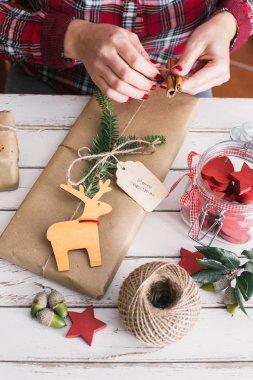 Woman wrapping cool christmas gift
