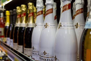 Large selection of champagne on store shelves. Traditional holidays and events. Close-up. Moscow, Russia, 12-24-2020.