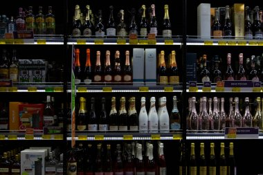 Large selection of champagne on store shelves. Traditional holidays and events. Close-up. Front view. Moscow, Russia, 12-24-2020.