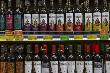 Assorted alcohol on the shelves in the store. Big choice. Traditional holidays and events. Front view. Moscow, Russia, 12-24-2020.