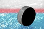 Schwarze Hockeypuck