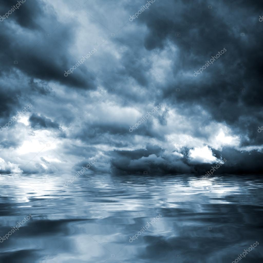 Dark storm clouds before rain above the water level.