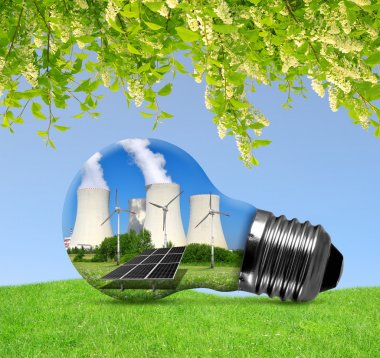 Nuclear power plant with solar panel and wind turbines in lightbulb