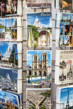 PARIS, FRANCE, on JULY 8, 2016. Art cards with views of Paris are presented on a show-window of shop