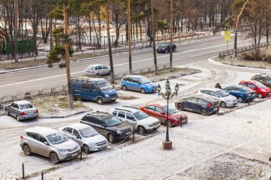 Pushkino, Russia, on November 17, 2014. The first snow in the city. Cars stand on a parking in the inhabited massif