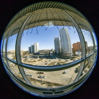 Pushkino, Russia, on March 17, 2015. A view of the city in the sunny spring afternoon from a window of shopping center, fisheye view.
