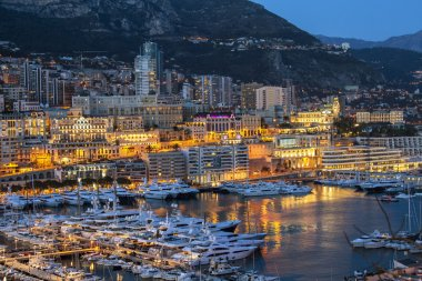 Monaco, France, on March 8, 2015. The top view on the port and the residential area at night