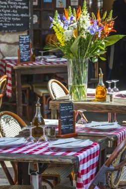 Nice, France, on March 7, 2015. Little tables of summer cafe in the old city