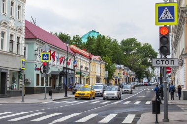 MOSCOW, RUSSIA, on MAY 24, 2015. Pokrovskaya Street. Summer day, rainy weather. Pokrovskaya Street is historical sight of the center of Moscow and one of shopping streets