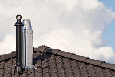 Modern chimney on roof