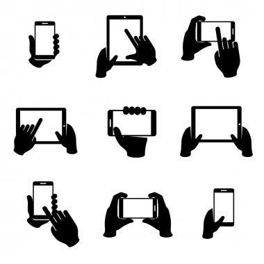 Hands holding phone and tablet vector icons set