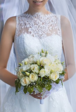 Bride in White Dress Holding Splendid Bridal Boquet