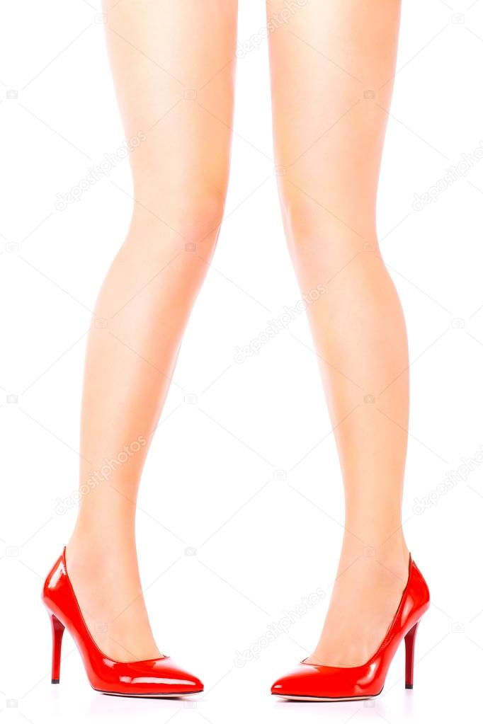 Sexy Legs In Red High Heels On White Background Stock Photo
