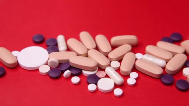 Various pills macro on red background. Top view