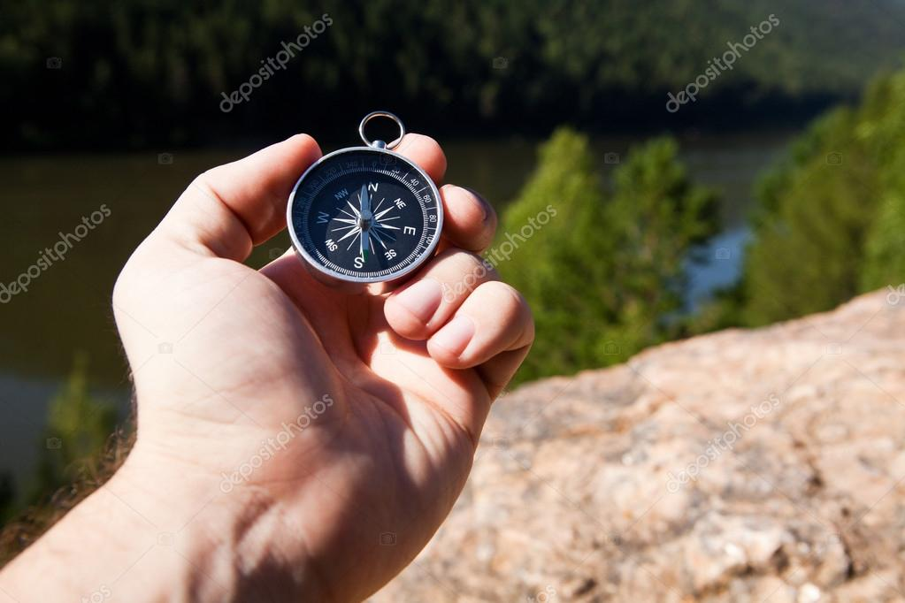 Hand holding the compass