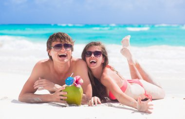 close up of young couple enjoying their time drinking a coconut cocktail