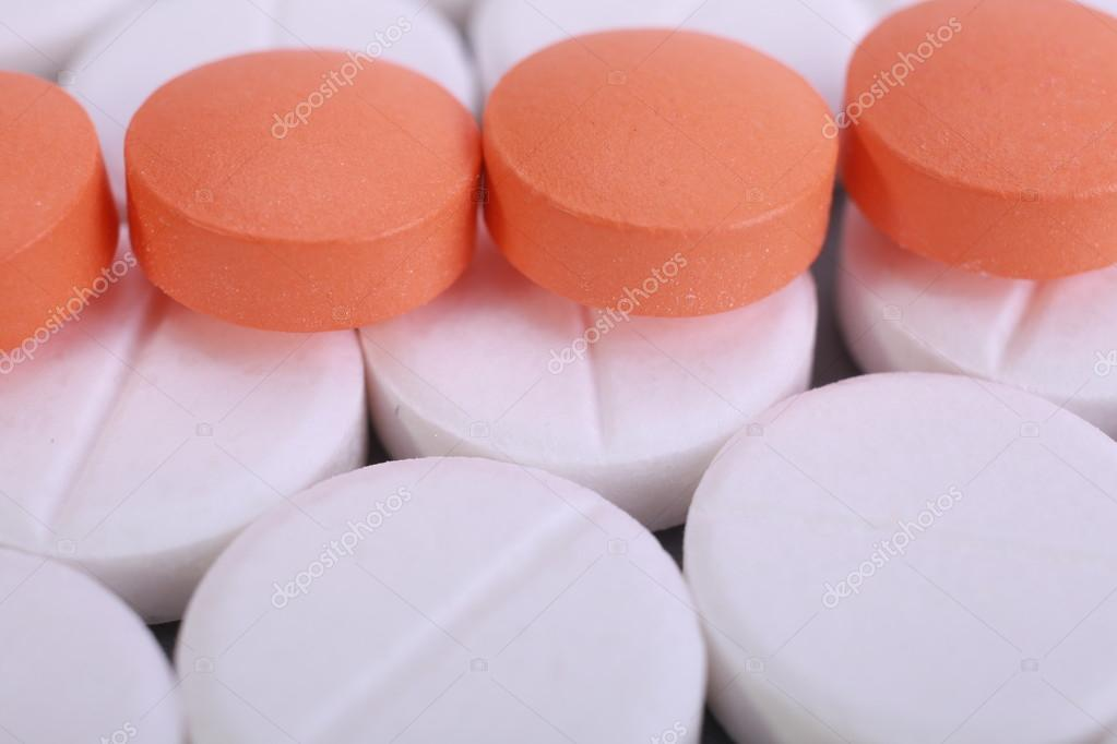 red and white pill capsules pile stock photo vtv vipgrup 61118381