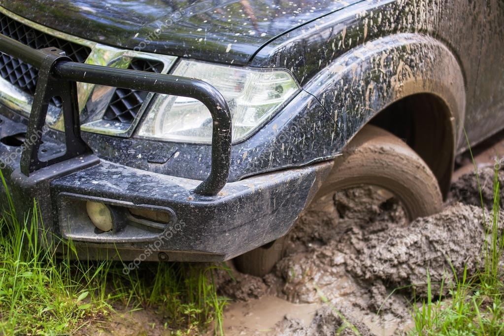 SUV got stuck in the mud, wheel closeup