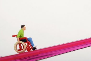 Miniature of a disabled man on a wheelchair