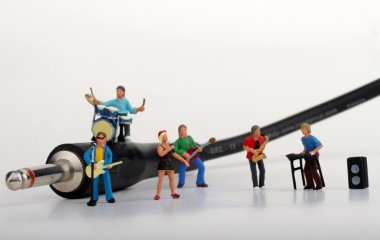 Miniature of a rock band performing