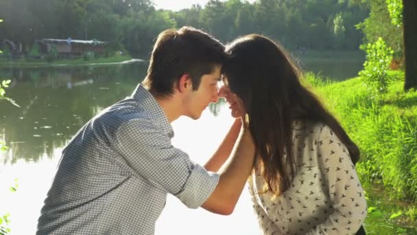 Young loving couple kissing in the park