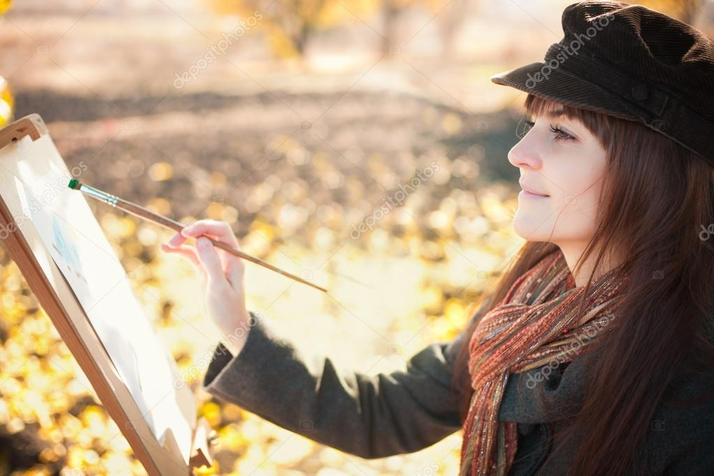 Portrait of the young beautiful woman with brush