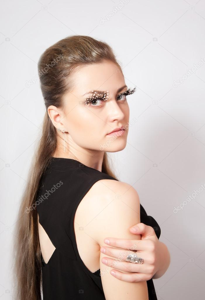 0669445bf6b Beautiful woman with big eyelashes and face-art — Stock Photo ...