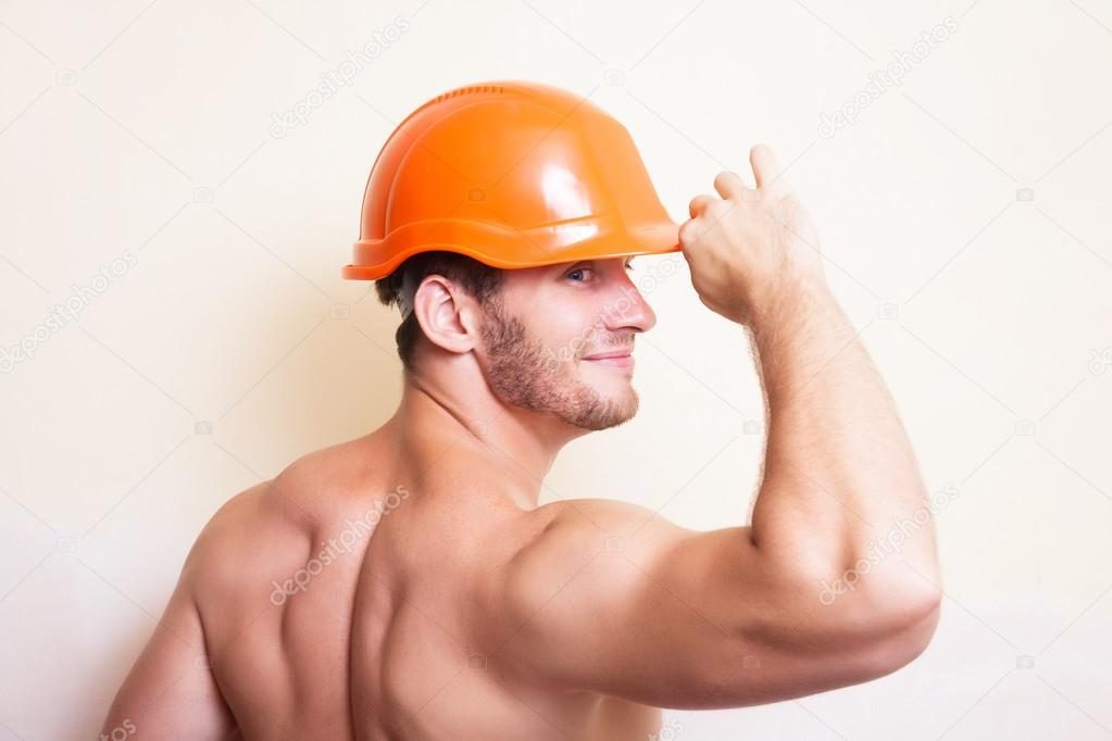 Attractive young man in a helmet