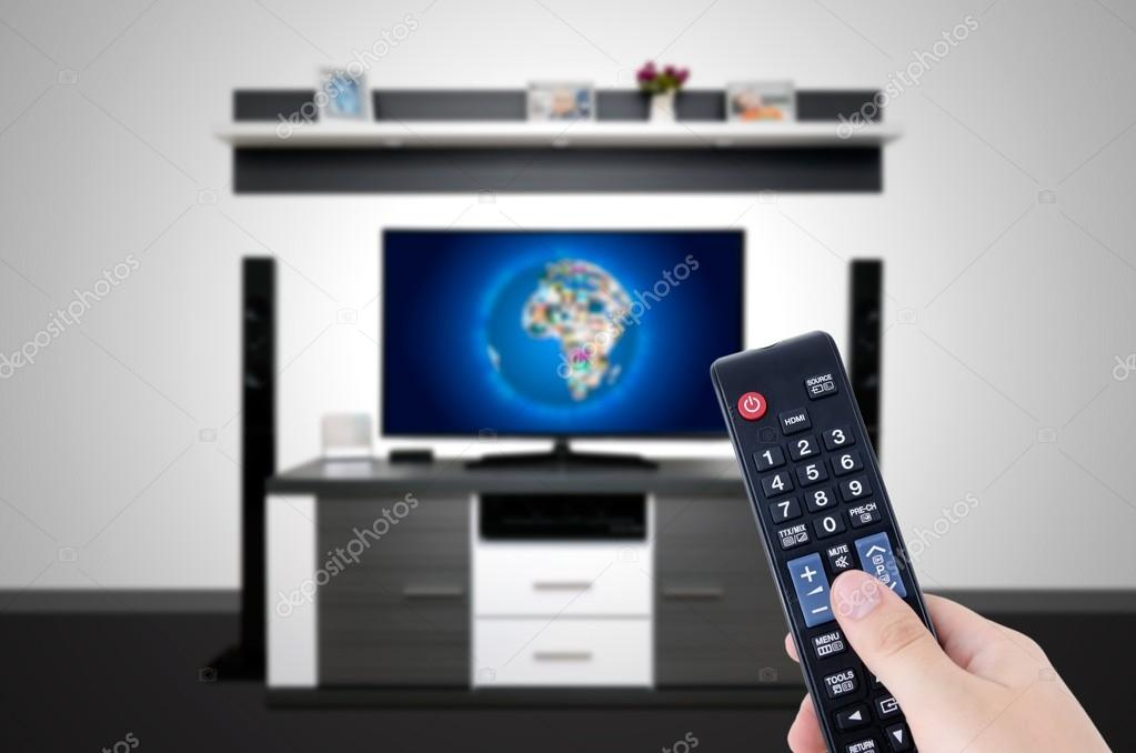 Watching television in modern TV room  Hand holding remote — Stock