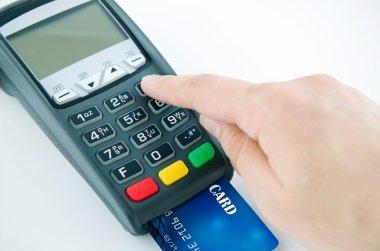Man using payment terminal keypad, enter personal identyfication