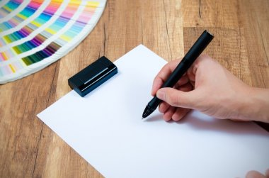 Graphic designer working with modern digitized pen
