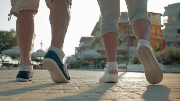 Active senior people jogging on resort