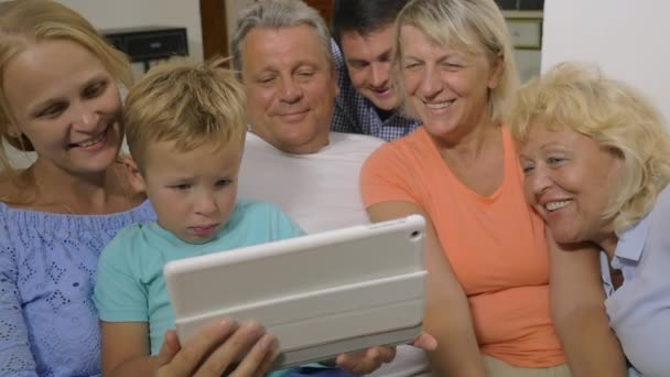 Big family watching video on touch pad