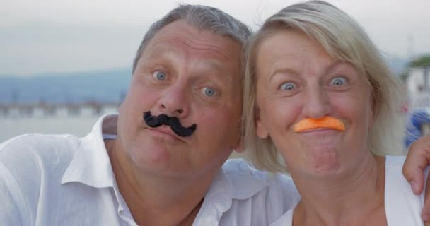 Funny senior couple with moustache