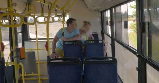 Parents and son riding in the bus