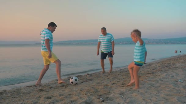 Men and Boy Playing Football on the Beach