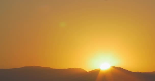 Sun rising from behind the hills