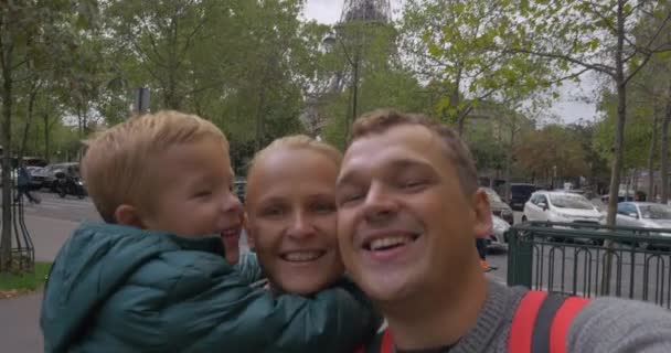 Family of tourists making selfie video in Paris