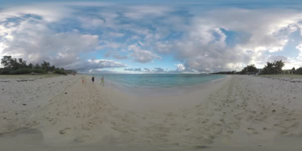 360 VR Parents and child running along the coast on resort of Mauritius