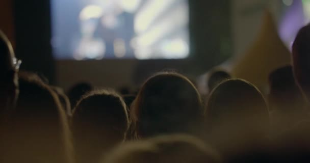 In MSU, Moscow on a concert We are together of musical group Kino crowd of people look at the scene and clap over head