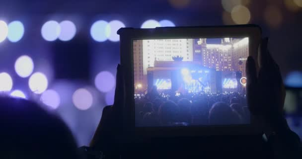 In MSU, Moscow on a concert We are together of musical group Kino young girl records video on the tablet