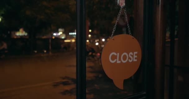 Changing store door sign from Open to Close at night