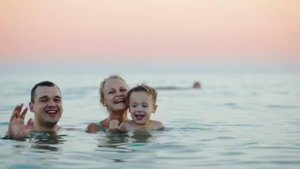 Family bathing in sea