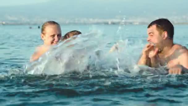 Family Having Fun In Water