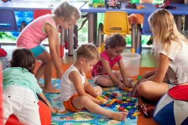 Children playing games in nursery